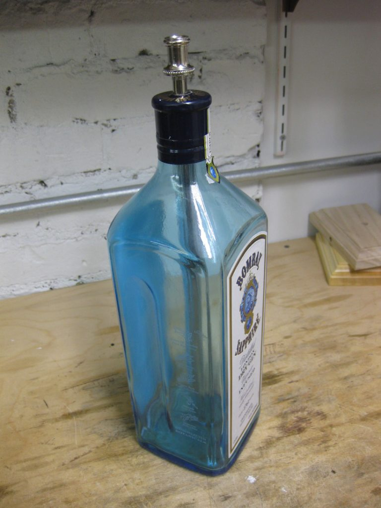 Bottle with rod